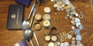 gold and silver coins and jewelry
