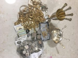 photo mix of gold jewelry and silver coins