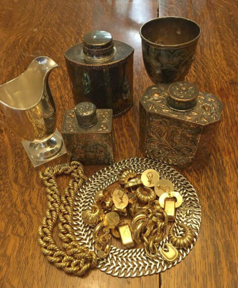 gold and english silver canisters